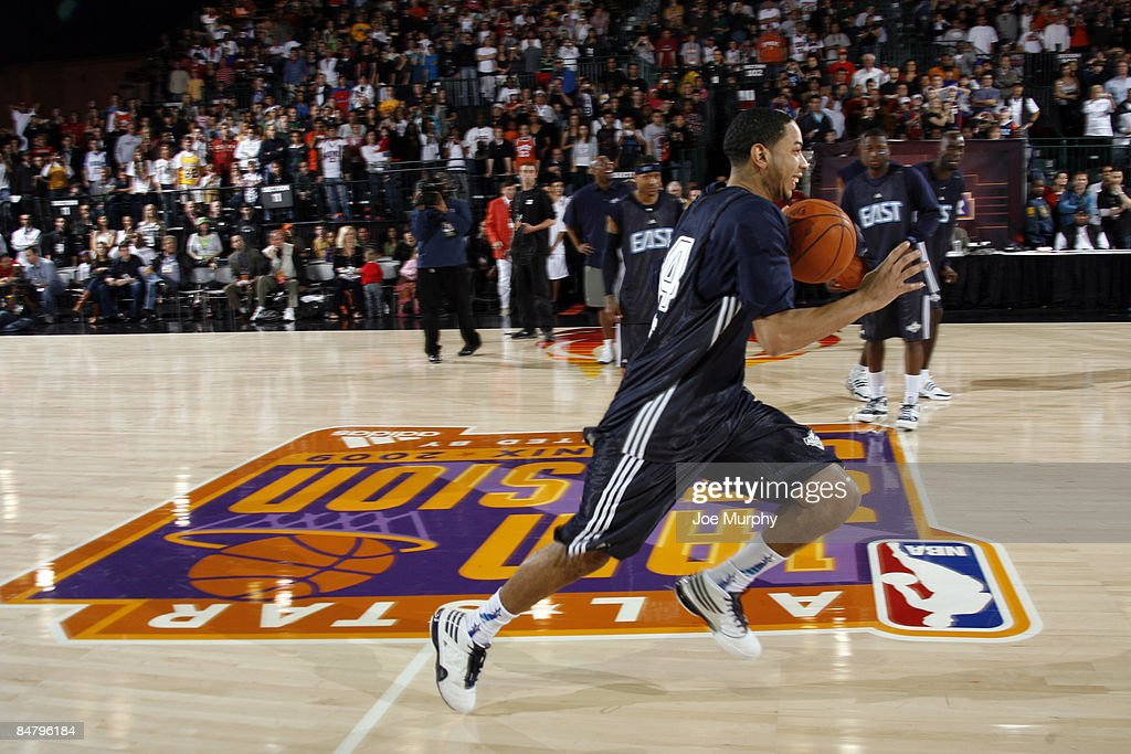 Devin Harris of the East AllStars tries to beat the Guinness World Record for fastest dribbling from base line to base line during the East AllStars...