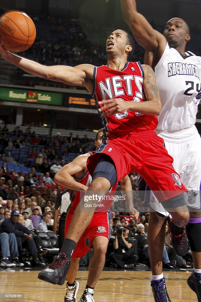 <a gi-track='captionPersonalityLinkClicked' href=/galleries/search?phrase=Devin+Harris&family=editorial&specificpeople=202195 ng-click='$event.stopPropagation()'>Devin Harris</a> #34 of the New Jersey Nets gets to the basket against <a gi-track='captionPersonalityLinkClicked' href=/galleries/search?phrase=Carl+Landry&family=editorial&specificpeople=4111952 ng-click='$event.stopPropagation()'>Carl Landry</a> #24 of the Sacramento Kings on November 19, 2010 at ARCO Arena in Sacramento, California.
