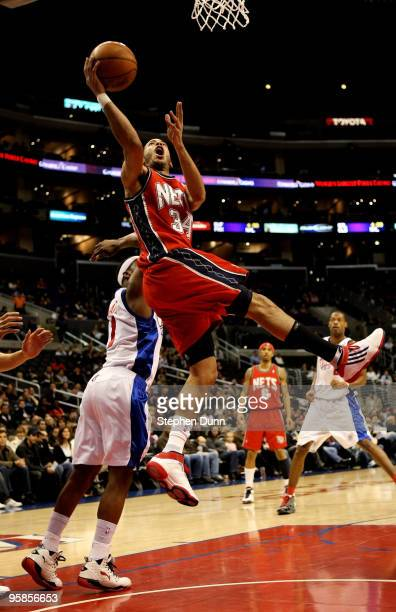 Devin Harris of the New Jersey Nets goes for a shot over Baron Davis of the Los Angeles Clippers on January 18 2010 at Staples Center in Los Angeles...
