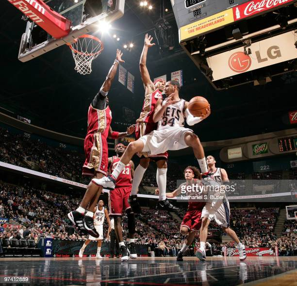 Devin Harris of the New Jersey Nets looks to pass against the Cleveland Cavaliers on March 3 2010 at the IZOD Center in East Rutherford New Jersey...