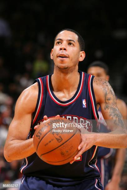 Devin Harris of the New Jersey Nets shoots a free throw during the game against the Golden State Warriors at Oracle Arena on March 11 2009 in Oakland...