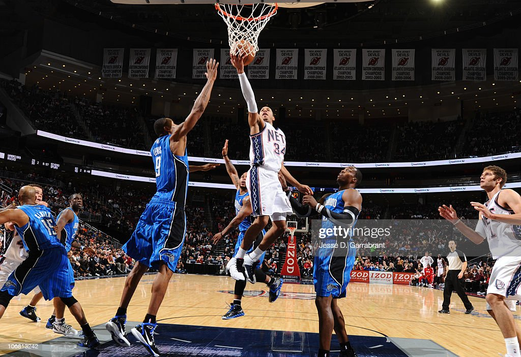 ... Devin Harris 34 of the New Jersey Nets shoots against Dwight Howard 12  of ... 40ce109e4