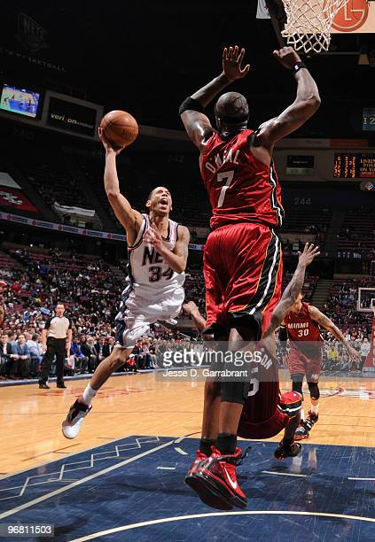 Devin Harris of the New Jersey Nets shoots against Jermaine O'Neal of the Miami Heat during the game on February 17 2010 at the Izod Center in East...