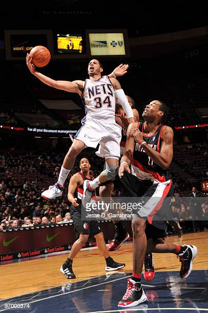 Devin Harris of the New Jersey Nets shoots against Marcus Camby of the Portland Trail Blazers during the game on February 23 2010 at the Izod Center...
