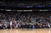 Devin Harris of the Utah Jazz gets his shot blocked in the last second of overtime by Kobe Bryant of the Los Angeles Lakers at Energy Solutions Arena...