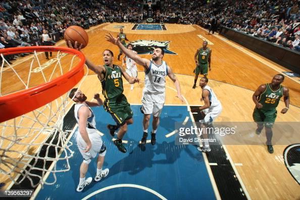 Devin Harris of the Utah Jazz goes to the basket against Nikola Pekovic of the Minnesota Timberwolves during the game between the Minnesota...