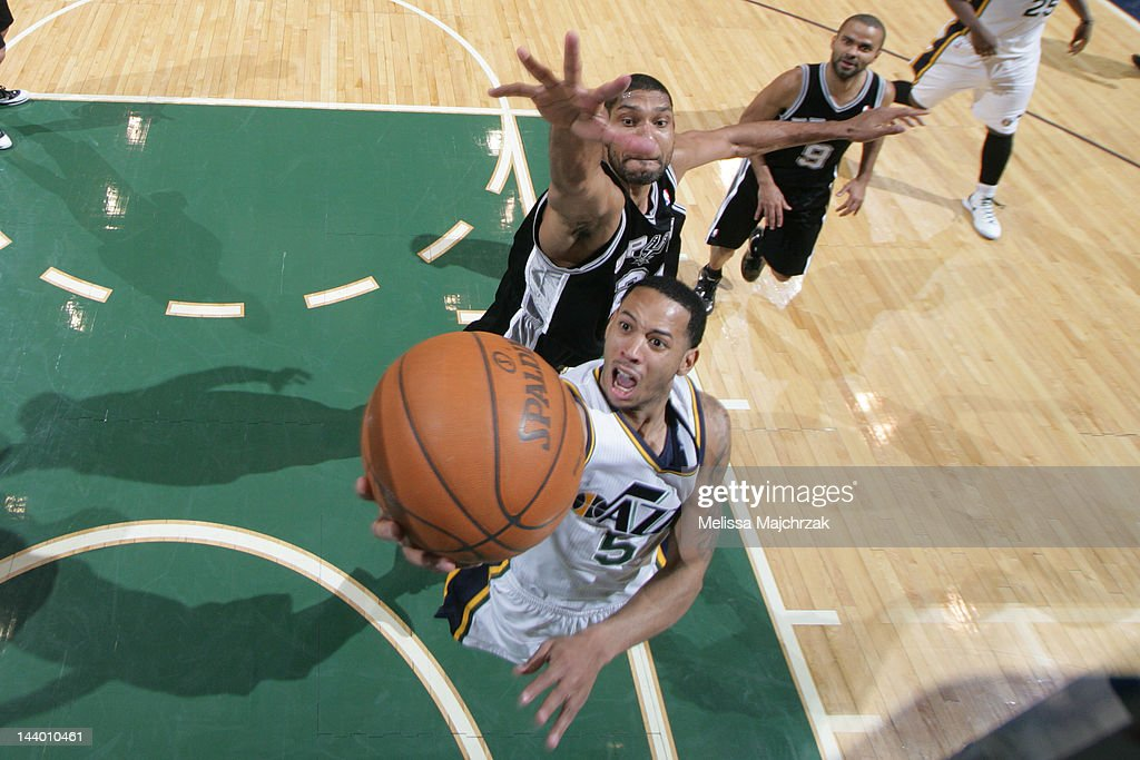 <a gi-track='captionPersonalityLinkClicked' href=/galleries/search?phrase=Devin+Harris&family=editorial&specificpeople=202195 ng-click='$event.stopPropagation()'>Devin Harris</a> #5 of the Utah Jazz goes to the basket against <a gi-track='captionPersonalityLinkClicked' href=/galleries/search?phrase=Tim+Duncan&family=editorial&specificpeople=201467 ng-click='$event.stopPropagation()'>Tim Duncan</a> #21 of the San Antonio Spurs in Game Four of the Western Conference Quarterfinals during the 2012 NBA Playoffs at Energy Solutions Arena on May 7, 2012 in Salt Lake City, Utah.
