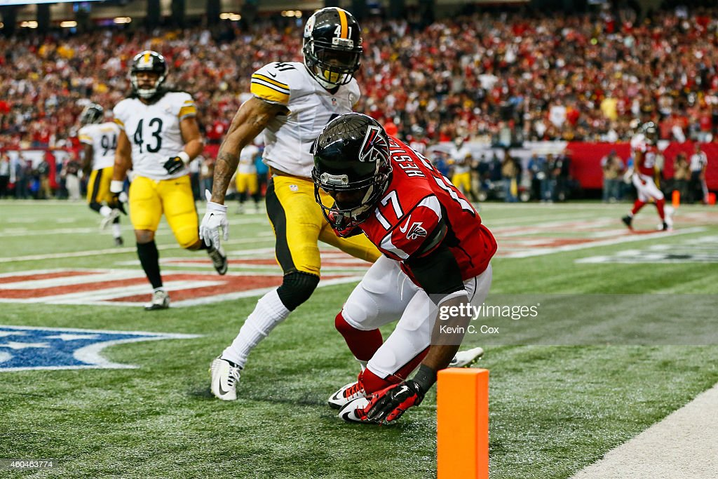 Devin Hester of the Atlanta Falcons catches a touchdown pass over Antwon Blake of the Pittsburgh Steelers in the first half at the Georgia Dome on...