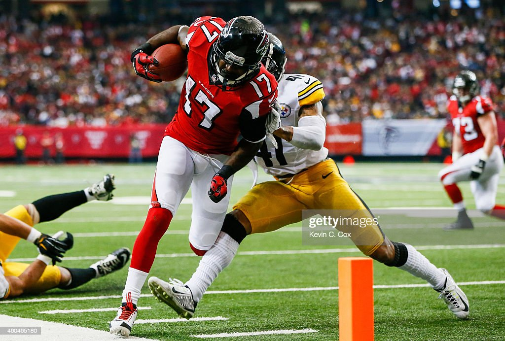 Devin Hester of the Atlanta Falcons is forced out of bounds by Antwon Blake of the Pittsburgh Steelers in the second half at the Georgia Dome on...