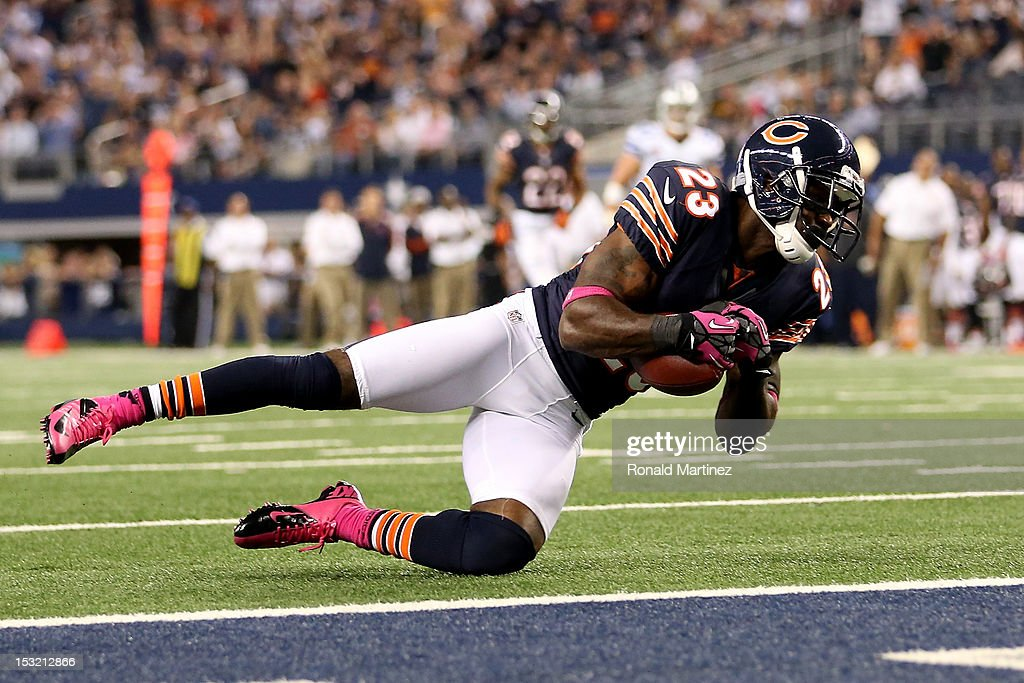 <a gi-track='captionPersonalityLinkClicked' href=/galleries/search?phrase=Devin+Hester&family=editorial&specificpeople=589809 ng-click='$event.stopPropagation()'>Devin Hester</a> #23 of the Chicago Bears catches a 34-yard touchdown reception in the third quarter against the Dallas Cowboys at Cowboys Stadium on October 1, 2012 in Arlington, Texas.