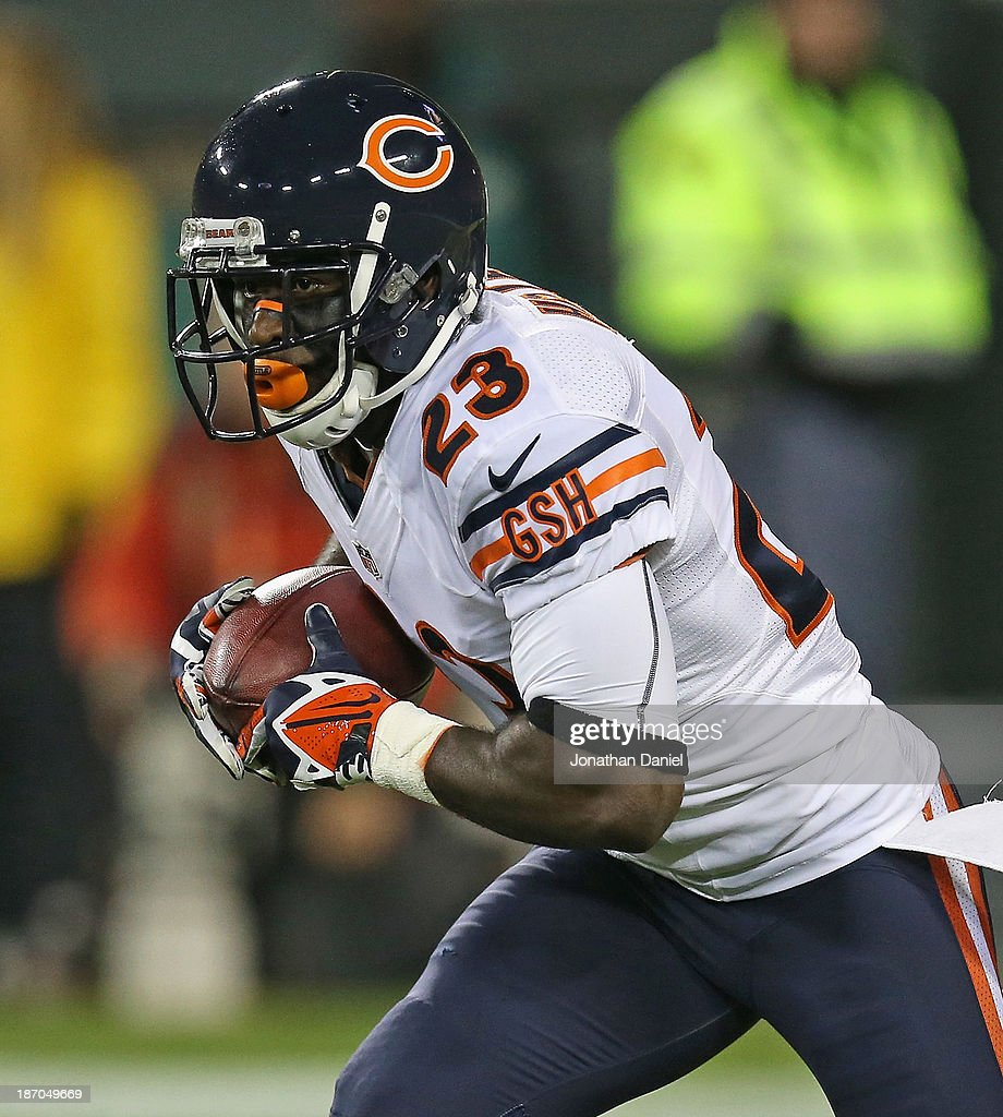 <a gi-track='captionPersonalityLinkClicked' href=/galleries/search?phrase=Devin+Hester&family=editorial&specificpeople=589809 ng-click='$event.stopPropagation()'>Devin Hester</a> #23 of the Chicago Bears fields a punt against the Green Bay Packers at Lambeau Field on November 4, 2013 in Green Bay, Wisconsin. The Bears defeated the Packers 27-20.