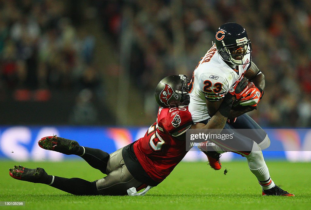 <a gi-track='captionPersonalityLinkClicked' href=/galleries/search?phrase=Devin+Hester&family=editorial&specificpeople=589809 ng-click='$event.stopPropagation()'>Devin Hester</a> #23 of the Chicago Bears is tackled by <a gi-track='captionPersonalityLinkClicked' href=/galleries/search?phrase=Aqib+Talib&family=editorial&specificpeople=4037138 ng-click='$event.stopPropagation()'>Aqib Talib</a> #25 of the Tampa Bay Buccaneers during the NFL International Series match between Chicago Bears and Tampa Bay Buccaneers at Wembley Stadium on October 23, 2011 in London, England. This is the fifth occasion where a regular season NFL match has been played in London.