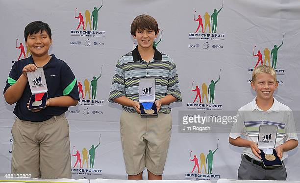 Devin Kim second place winner Miles Martin first place winner and Bradley Sawka third place winner in the Boys 1011 Chipping Competition pose with...