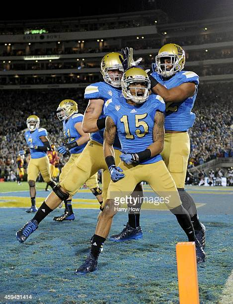 Devin Lucien of the UCLA Bruins celebrates his touchdown to tie the score 77 against the USC Trojans during the first quarter at the Rose Bowl on...