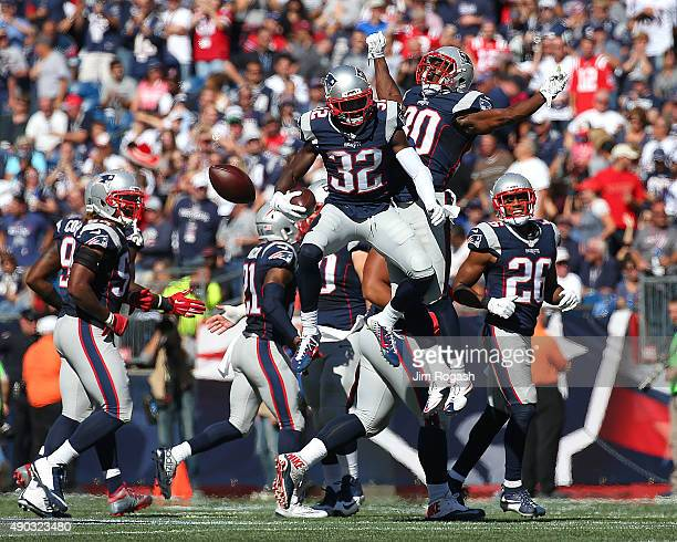 Devin McCourty of the New England Patriots celebrates his interception with Duron Harmon of the New England Patriots in the second quarter against...