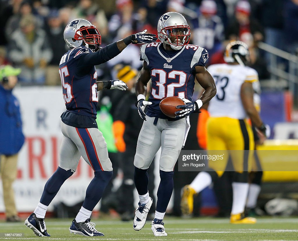 <a gi-track='captionPersonalityLinkClicked' href=/galleries/search?phrase=Devin+McCourty&family=editorial&specificpeople=4510365 ng-click='$event.stopPropagation()'>Devin McCourty</a> #32 of the New England Patriots celebrates his interception with <a gi-track='captionPersonalityLinkClicked' href=/galleries/search?phrase=Kyle+Arrington&family=editorial&specificpeople=5443555 ng-click='$event.stopPropagation()'>Kyle Arrington</a> #25 during a game with Pittsburgh Steelers in the second half at Gillette Stadium on November 3, 2013 in Foxboro, Massachusetts.