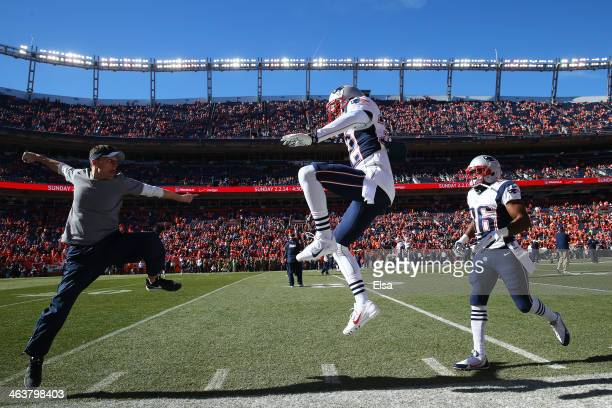Devin McCourty of the New England Patriots jumps on the field during warmups prior to their AFC Championship game against the Denver Broncos at...