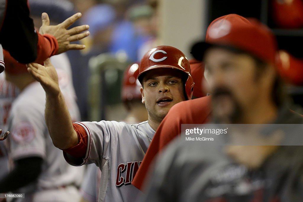 <a gi-track='captionPersonalityLinkClicked' href=/galleries/search?phrase=Devin+Mesoraco&family=editorial&specificpeople=5745587 ng-click='$event.stopPropagation()'>Devin Mesoraco</a> #39 of the Cincinnati Reds celebrates after scoring on a double by Zack Cozart (not pictured) in the top of the fifth inning against the Milwaukee Brewers at Miller Park on August 15, 2013 in Milwaukee, Wisconsin.