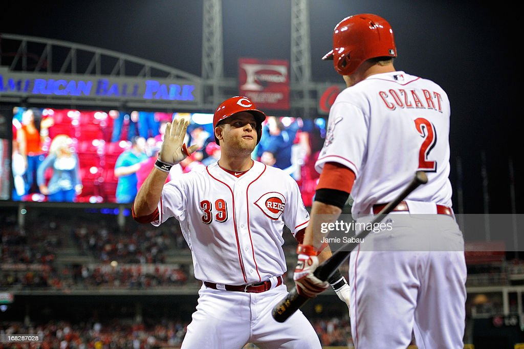 Devin Mesoraco #39 of the Cincinnati Reds celebrates his ninth-inning pinch hit home run that tied the game against the Atlanta Braves with Zack Cozart #2 of the Cincinnati Reds at Great American Ball Park on May 7, 2013 in Cincinnati, Ohio. Cincinnati defeated Atlanta 5-4.