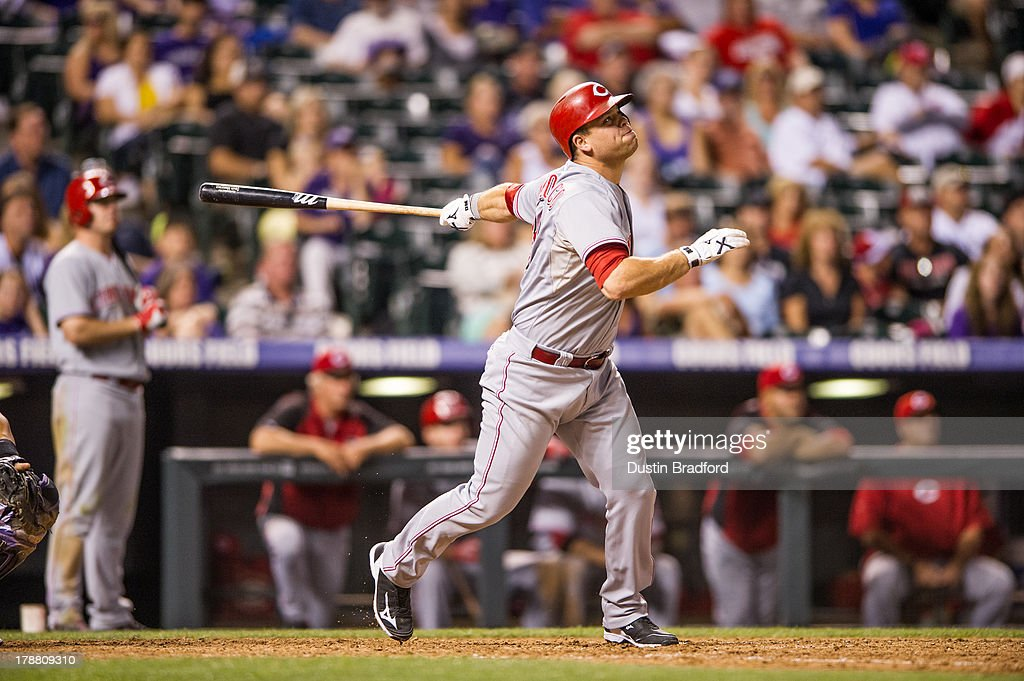 <a gi-track='captionPersonalityLinkClicked' href=/galleries/search?phrase=Devin+Mesoraco&family=editorial&specificpeople=5745587 ng-click='$event.stopPropagation()'>Devin Mesoraco</a> #39 of the Cincinnati Reds hits a ninth inning sacrifice fly to score teammate Brandon Phillips #4 (not pictured) during a game against the Colorado Rockies at Coors Field on August 30, 2013 in Denver, Colorado. The Rockies beat the Reds 9-6.
