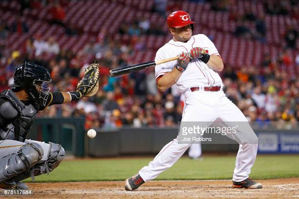 Devin Mesoraco of the Cincinnati Reds is hit by a pitch in the fourth inning of a game against the Pittsburgh Pirates at Great American Ball Park on...