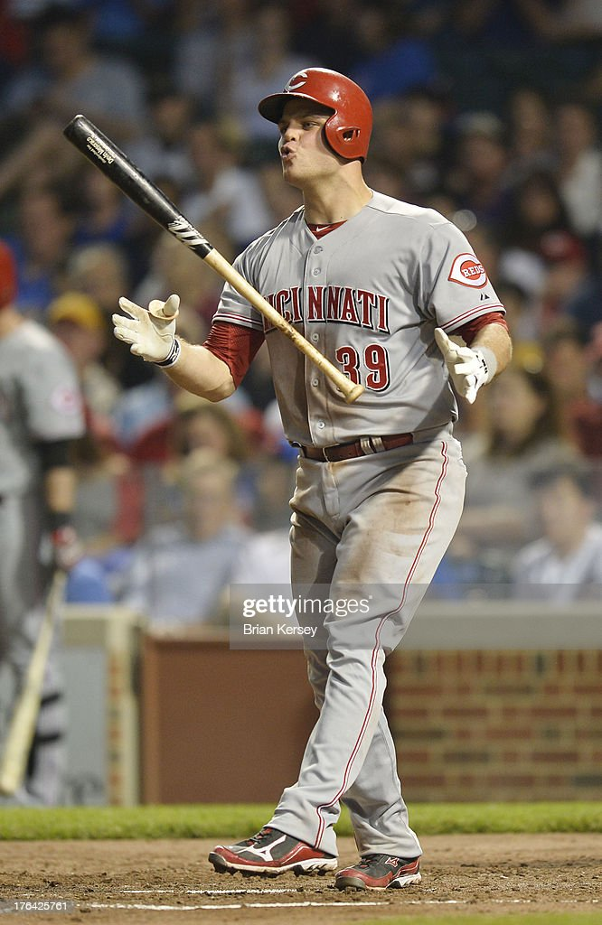 <a gi-track='captionPersonalityLinkClicked' href=/galleries/search?phrase=Devin+Mesoraco&family=editorial&specificpeople=5745587 ng-click='$event.stopPropagation()'>Devin Mesoraco</a> #39 of the Cincinnati Reds reacts after swinging at strike two during the fifth inning against the Chicago Cubs at Wrigley Field on August 12, 2013 in Chicago, Illinois.