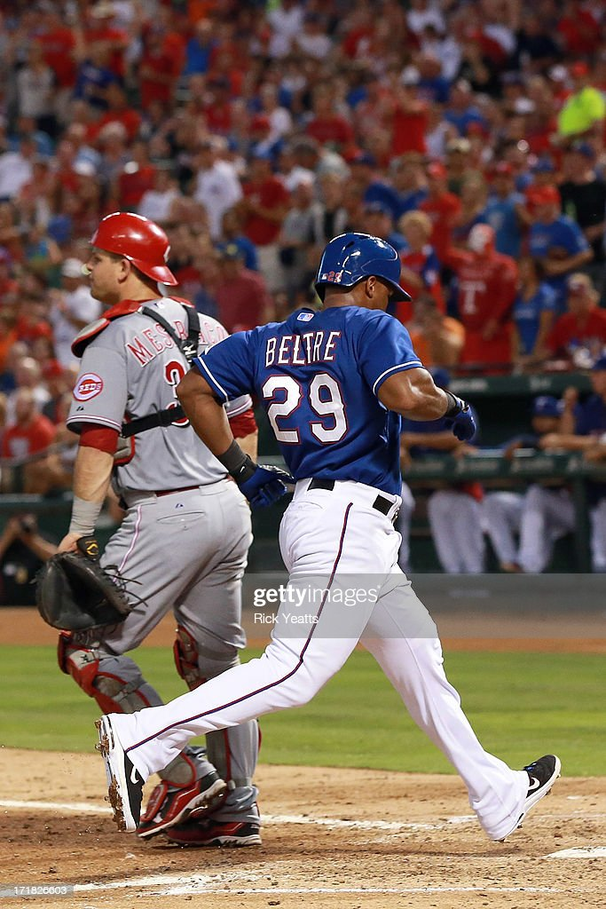 <a gi-track='captionPersonalityLinkClicked' href=/galleries/search?phrase=Devin+Mesoraco&family=editorial&specificpeople=5745587 ng-click='$event.stopPropagation()'>Devin Mesoraco</a> #39 of the Cincinnati Reds reacts as <a gi-track='captionPersonalityLinkClicked' href=/galleries/search?phrase=Adrian+Beltre&family=editorial&specificpeople=202631 ng-click='$event.stopPropagation()'>Adrian Beltre</a> #29 of the Texas Rangers scores in the fifth inning on an RBI single hit by Jurickson Profar #13 of the Rangers at Rangers Ballpark in Arlington on June 28, 2013 in Arlington, Texas.