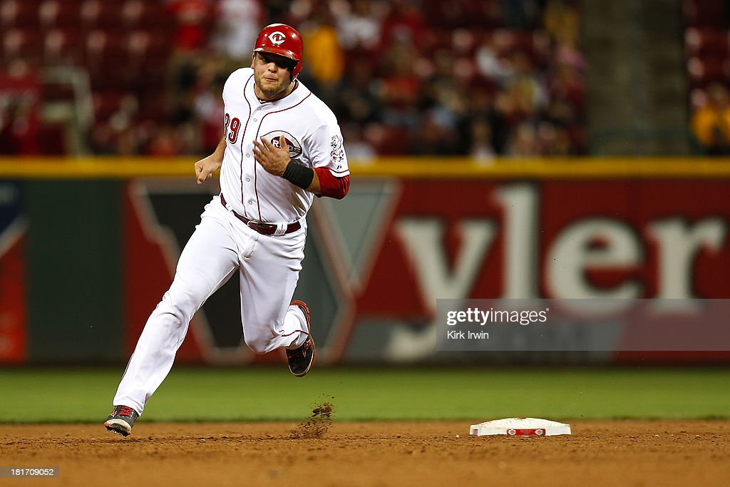 <a gi-track='captionPersonalityLinkClicked' href=/galleries/search?phrase=Devin+Mesoraco&family=editorial&specificpeople=5745587 ng-click='$event.stopPropagation()'>Devin Mesoraco</a> #39 of the Cincinnati Reds rounds second base before stopping at third during the 10th inning against the New York Mets at Great American Ball Park on September 23, 2013 in Cincinnati, Ohio. Mesoraco would score the winning run off of a walk-off double by <a gi-track='captionPersonalityLinkClicked' href=/galleries/search?phrase=Shin-Soo+Choo&family=editorial&specificpeople=196543 ng-click='$event.stopPropagation()'>Shin-Soo Choo</a> #17 of the Cincinnati Reds as Cincinnati defeated New York 3-2 in 10 innings.