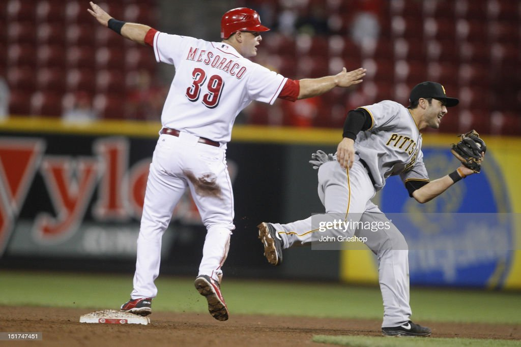 <a gi-track='captionPersonalityLinkClicked' href=/galleries/search?phrase=Devin+Mesoraco&family=editorial&specificpeople=5745587 ng-click='$event.stopPropagation()'>Devin Mesoraco</a> #39 of the Cincinnati Reds slides in safely at second base in front of <a gi-track='captionPersonalityLinkClicked' href=/galleries/search?phrase=Chase+d%27Arnaud&family=editorial&specificpeople=597643 ng-click='$event.stopPropagation()'>Chase d'Arnaud</a> #3 of the Pittsburgh Pirates during their game at Great American Ball Park on September 10, 2012 in Cincinnati, Ohio. The Reds defeated the Pirates 4-3 in 14 innings.