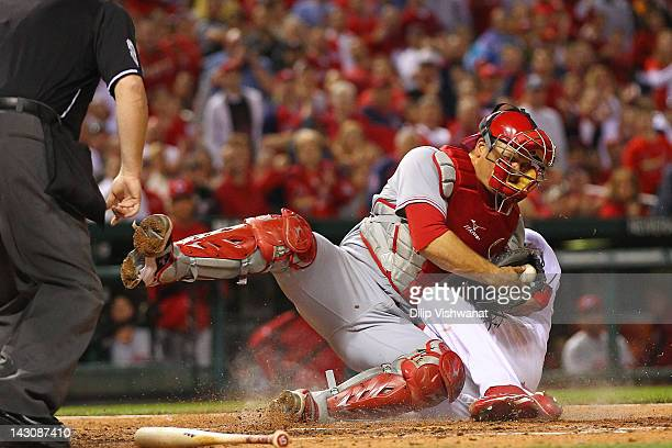 Devin Mesoraco of the Cincinnati Reds tags out Jaime Garcia of the St Louis Cardinals at Busch Stadium on April 18 2012 in St Louis Missouri