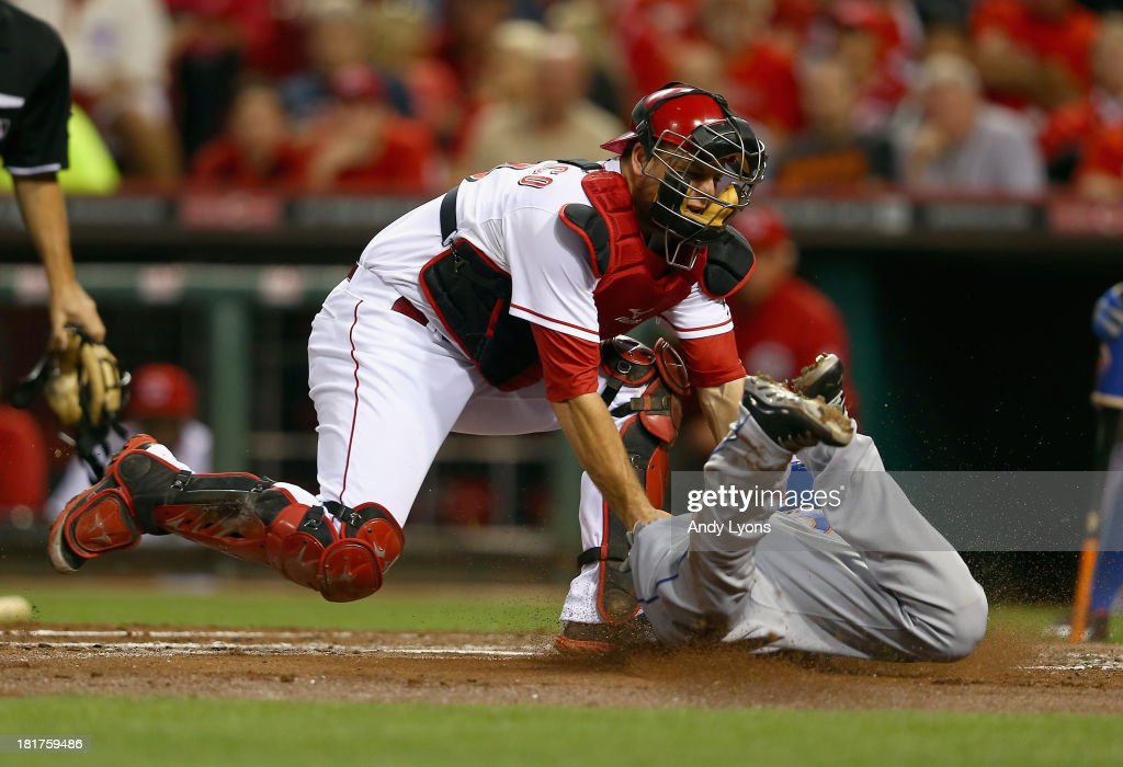 <a gi-track='captionPersonalityLinkClicked' href=/galleries/search?phrase=Devin+Mesoraco&family=editorial&specificpeople=5745587 ng-click='$event.stopPropagation()'>Devin Mesoraco</a> #39 of the Cincinnati Reds tags out Wilfredo Tovar #70 of the New York Mets at home plate in the second inning during the game at Great American Ball Park on September 24, 2013 in Cincinnati, Ohio.