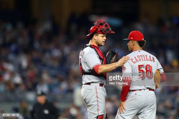 Devin Mesoraco speaks with Luis Castillo of the Cincinnati Reds on the mound during the game against the New York Yankees at Yankee Stadium on...