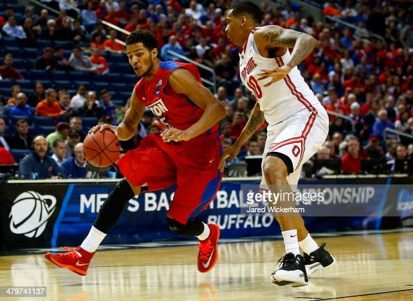 Devin Oliver of the Dayton Flyers drives to the basket as LaQuinton Ross of the Ohio State Buckeyes defends during the second round of the 2014 NCAA...