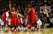 Devin Oliver of the Dayton Flyers reacts after defeating the Syracuse Orange 5553 in the third round of the 2014 NCAA Men's Basketball Tournament at...