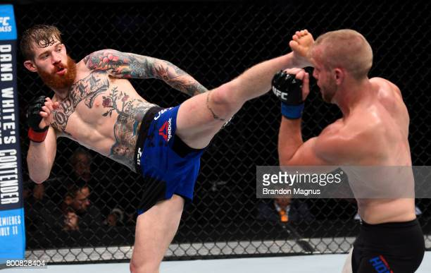 Devin Powell kicks Darrell Horcher in their lightweight bout during the UFC Fight Night event at the Chesapeake Energy Arena on June 25 2017 in...