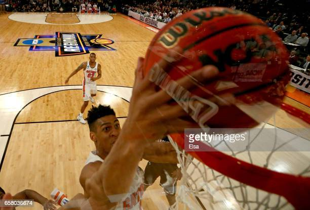 Devin Robinson of the Florida Gators dunks the ball against the South Carolina Gamecocks in the first half during the 2017 NCAA Men's Basketball...