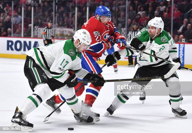 Devin Shore and Dan Hamhuis of the Dallas Stars defend against Alex Galchenyuk of the Montreal Canadiens in the NHL game at the Bell Centre on March...