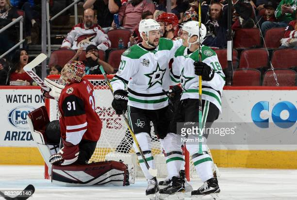 Devin Shore and Tyler Pitlick of the Dallas Stars celebrate in front of goalie Adin Hill of the Arizona Coyotes after a first period goal by teammate...