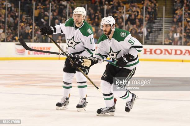 Devin Shore and Tyler Sequin of the Dallas Stars skate against the Boston Bruins at the TD Garden on March 30 2017 in Boston Massachusetts
