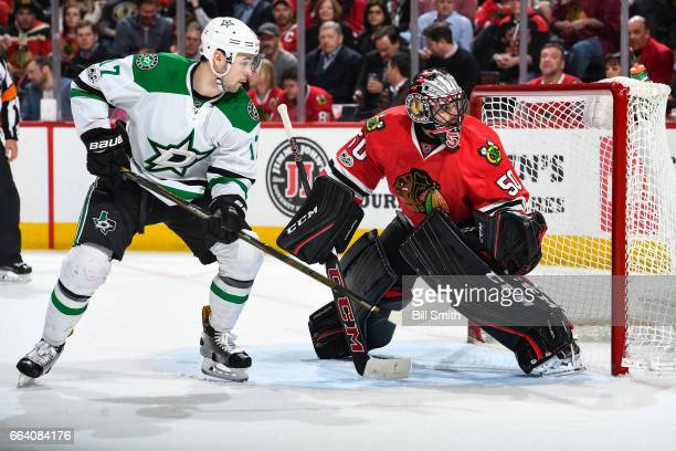 Devin Shore of the Dallas Stars and goalie Corey Crawford of the Chicago Blackhawks watches for the puck in the second period at the United Center on...