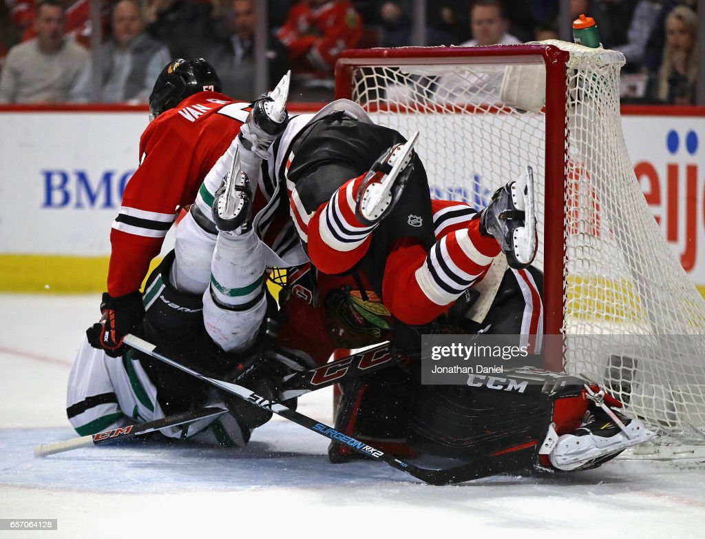 Devin Shore #17 of the Dallas Stars colides with Corey Crawford #50 and Trevor van Riemsdyk #57 of the Chicago Blackhawks at the United Center on March 23, 2017 in Chicago, Illinois.