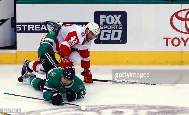 Devin Shore of the Dallas Stars collides with Martin Frk of the Detroit Red Wings in the third period at American Airlines Center on October 10 2017...