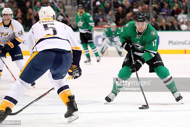 Devin Shore of the Dallas Stars controls the puck against Adam Pardy of the Nashville Predators in the first period at American Airlines Center on...