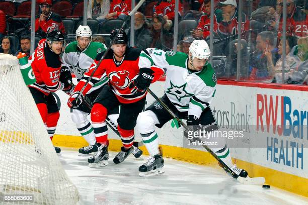 Devin Shore of the Dallas Stars plays the puck while being defended by Pavel Zacha of the New Jersey Devils during the game on March 26 2017 at...