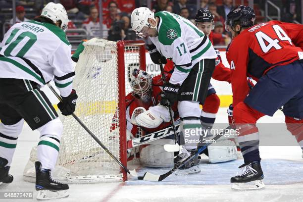 Devin Shore of the Dallas Stars scores a goal on goalie Braden Holtby of the Washington Capitals during the first period at Verizon Center on March 6...