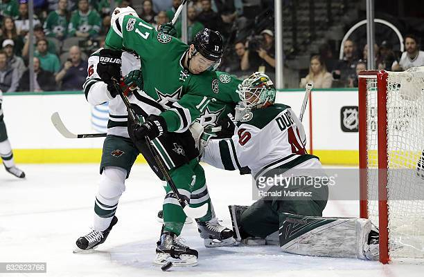 Devin Shore of the Dallas Stars takes a shot against Devan Dubnyk of the Minnesota Wild in the first period at American Airlines Center on January 24...