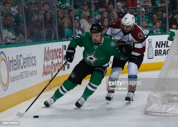 Devin Shore of the Dallas Stars tries to keep the puck away against Matt Nieto of the Colorado Avalanche at the American Airlines Center on April 8...