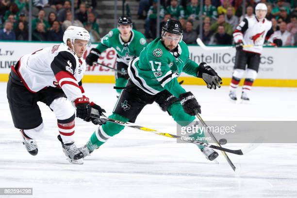 Devin Shore of the Dallas Stars tries to keep the puck away against Niklas Hjalmarsson of the Arizona Coyotes at the American Airlines Center on...