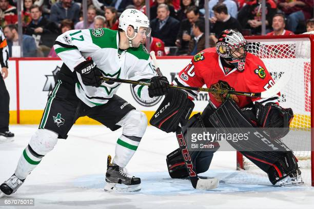 Devin Shore of the Dallas Stars watches for the puck next to goalie Corey Crawford of the Chicago Blackhawks in the second period at the United...