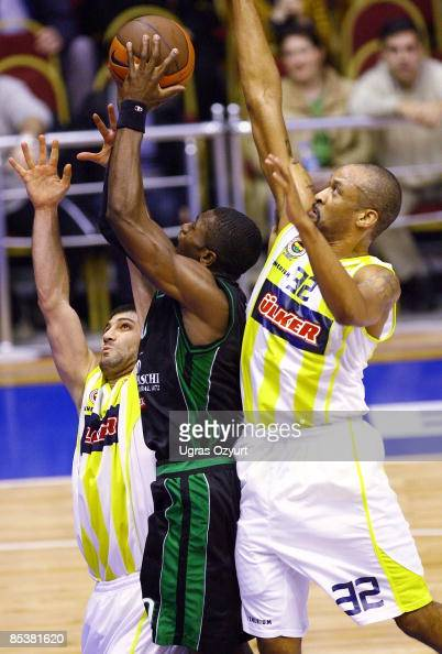 Devin Smith #32 of Fenerbahce Ulker competes with and Omer Onan #7 of Fenerbahce Ulker competes with and Romain Sato #10 of Montepaschi Siena...
